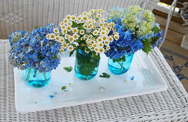 flowers on the porch in blue Ball canning jars