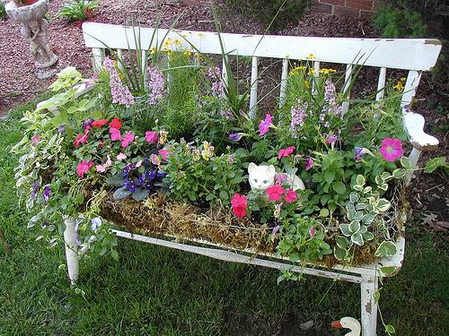 old garden bench as a planter