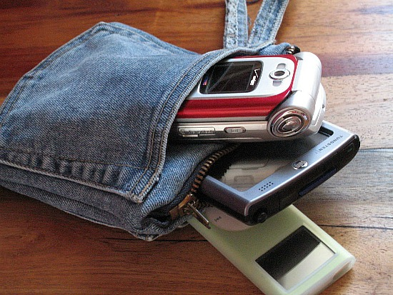 Fantastic ideas for repurposing old jeans like making a denim pouch for all your tech stuff!