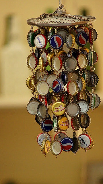8 Creative DIY wind chime ideas like this repurposed bottle cap wind chime!