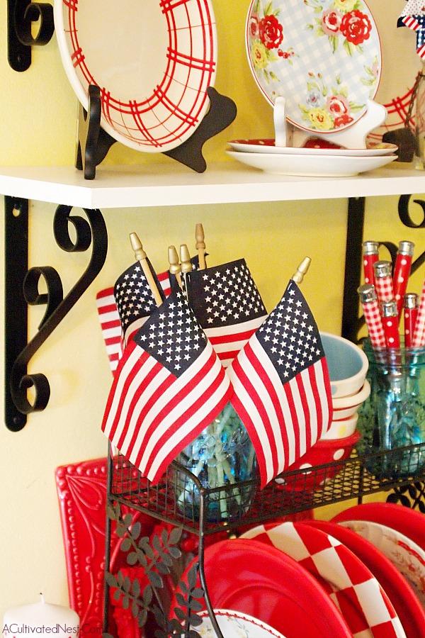 flags in a blue Ball Jar patriotic plate display