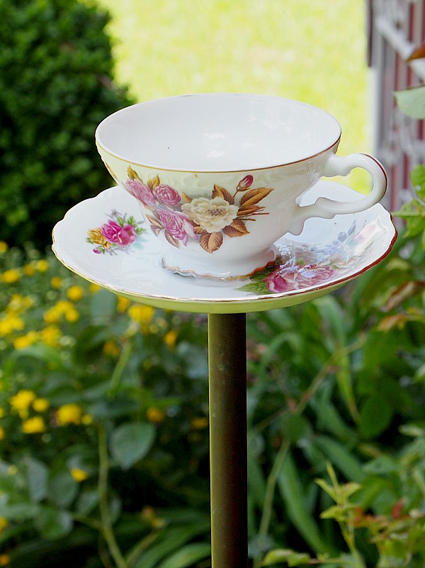 How To Make A DIY Teacup Birdfeeder. Easier to make than you think and so pretty in the garden. #DIY #gardenprojects #outdoorprojects