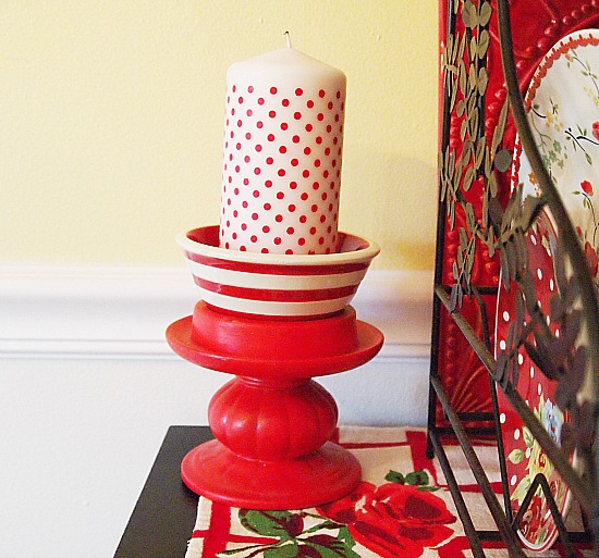 a cultivated nest red and white polka dot candle
