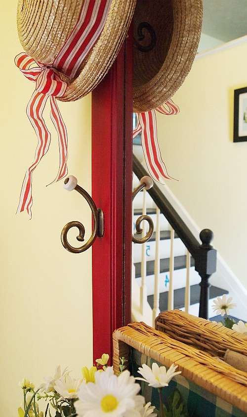 straw hat with red striped ribbon
