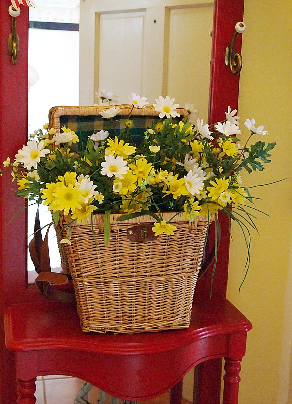 a cultivated nest wicker basket filled with summer flowers