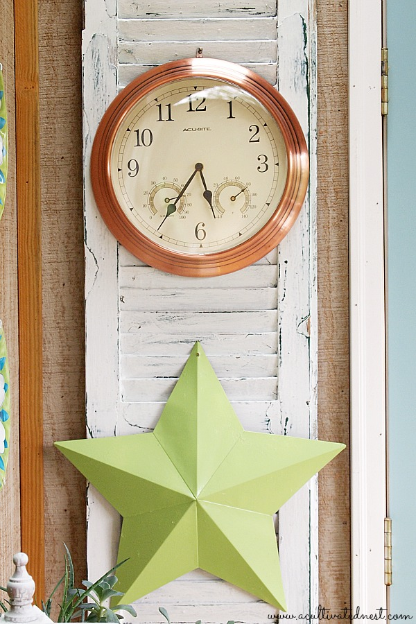 clock & star hanging on old shutters