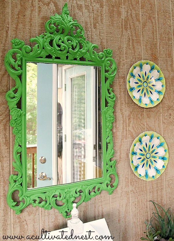 green scrolly mirror