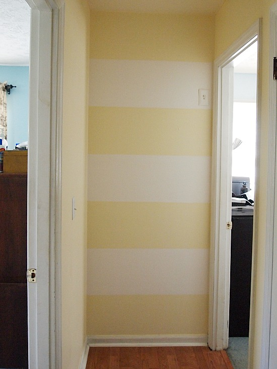 yellow and white stripes painted on a wall