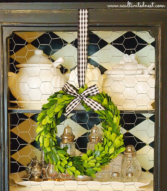 preserved boxwood wreath with gingham ribbon