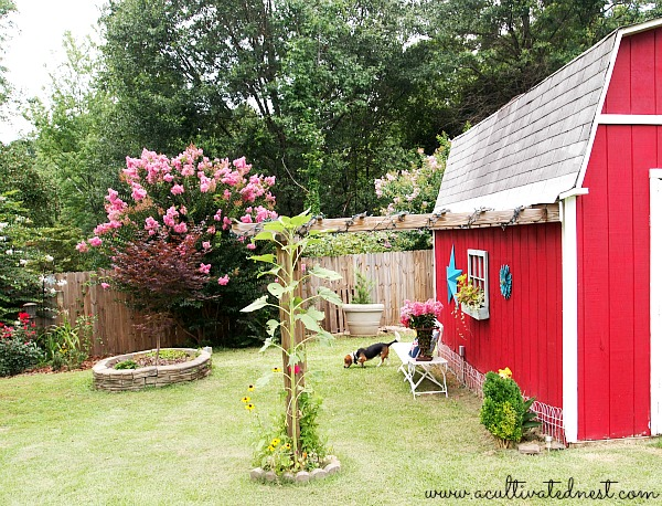 red barn with an attached arbor