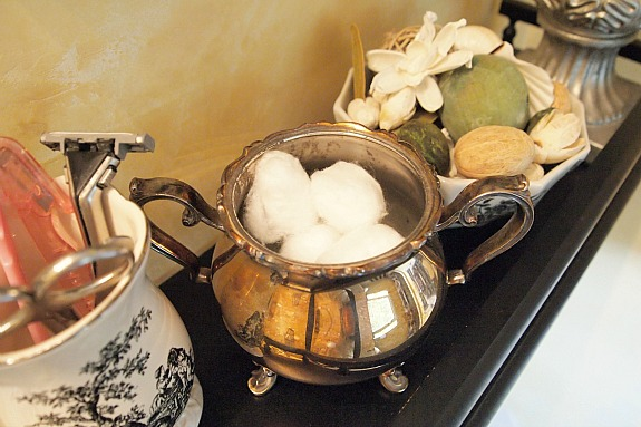 silver plate sugar bowl used as bathroom storage