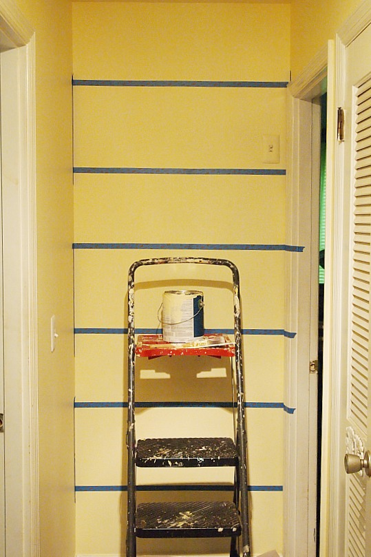taping off horizontal stripes on a wall