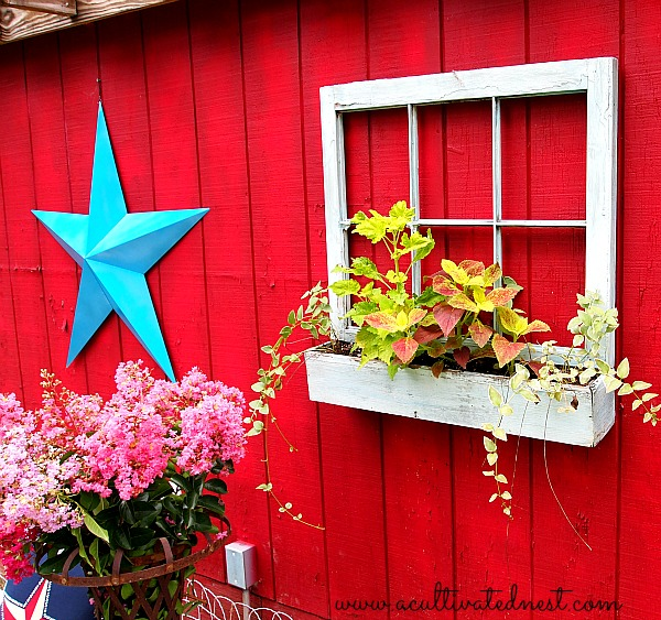 windowbox on red barn
