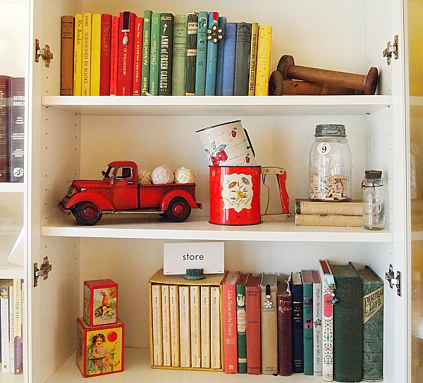 ikea bookcase with vintage books and decor items