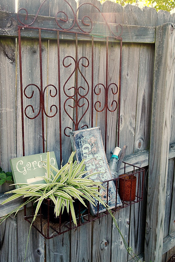 iron planter on fence