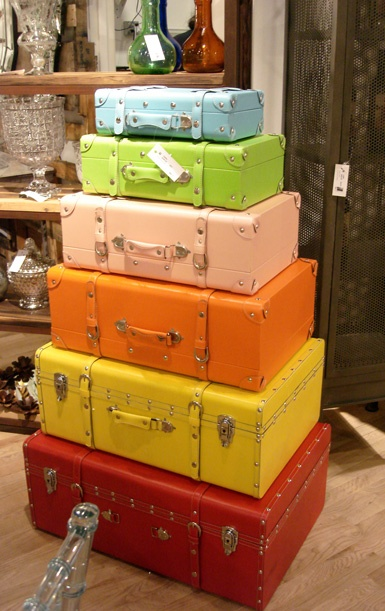 15 Ways To Repurpose A Suitcase - painted suitcases