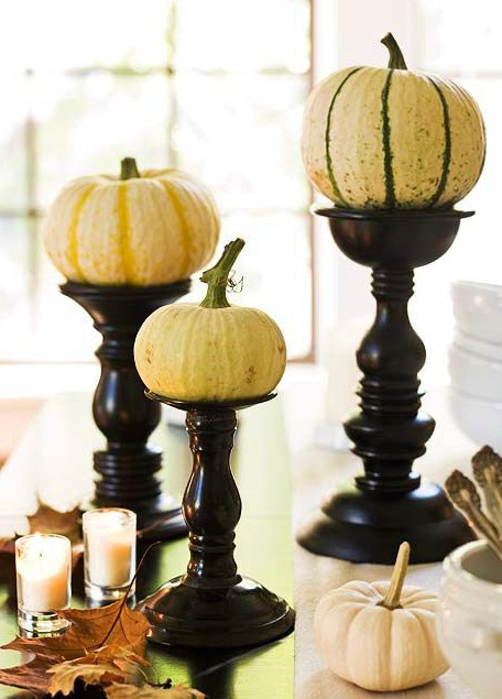 DIY Fall Decorating Ideas Roundup - use pumpkins on top of candle sticks