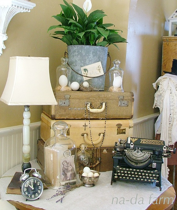 15 Ways To Repurpose A Suitcase - suitcases used in display