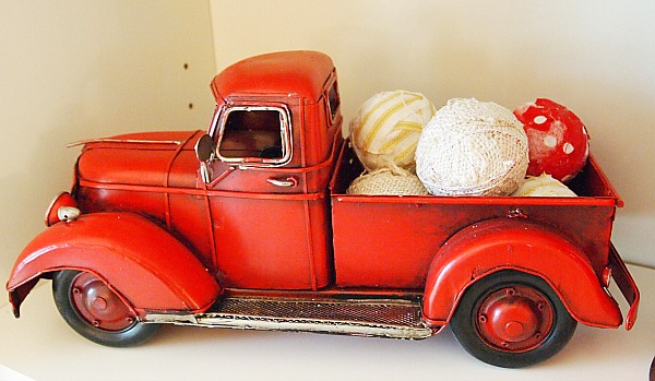 red truck filled with rag balls