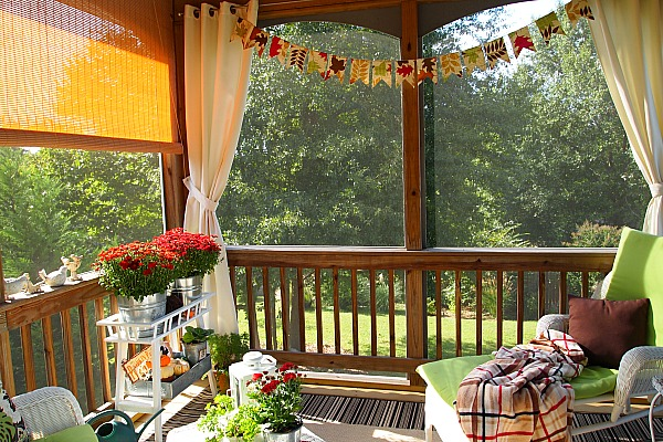 A Cultivated Nest fall decorated screened in porch