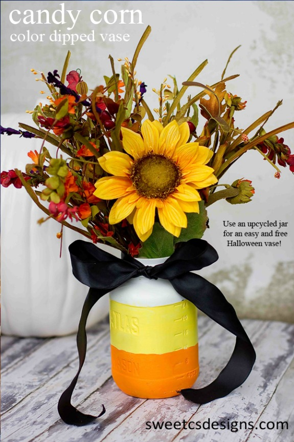 12 Candy Corn Inspired Fall Decorating ideas like this candy corn color dipped mason jar