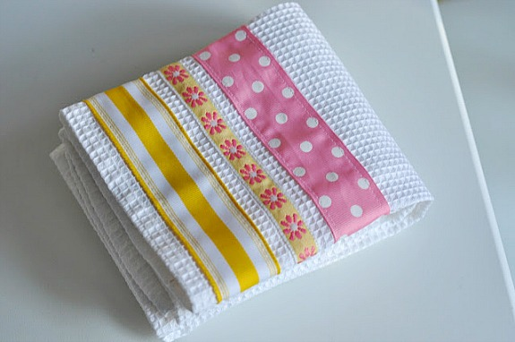 dish towel with ribbon sewn on it