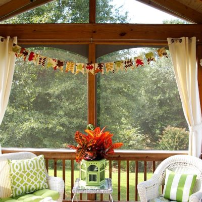 DIY banner hanging in the screened porch