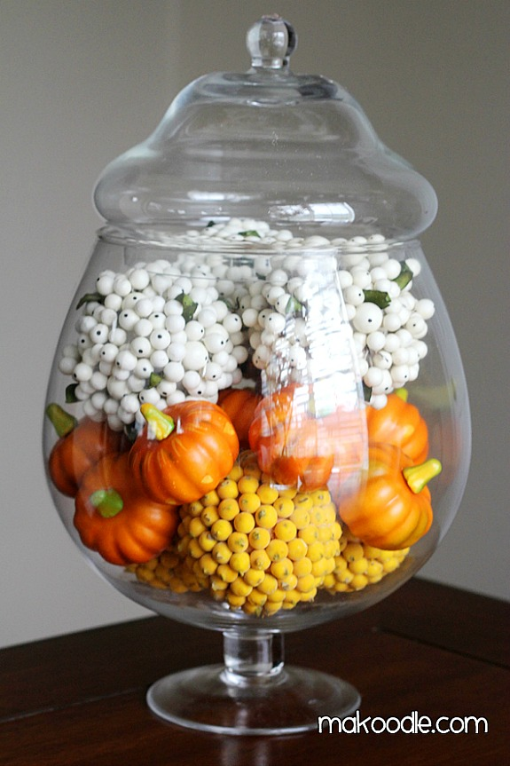 12 Candy Corn Inspired Fall Decorating Projects like this candy-corn-apothecary-jar