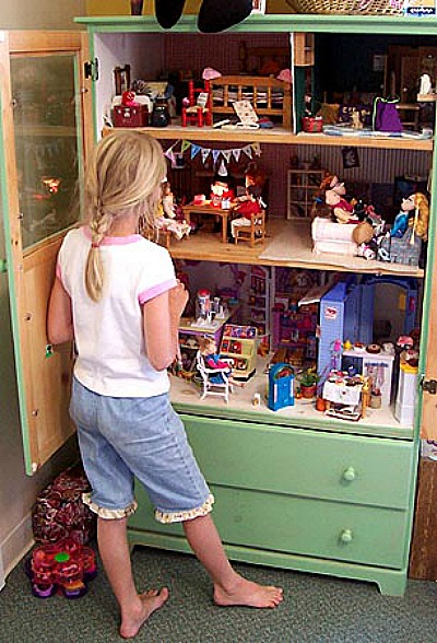 Dresser Dollhouse- If you have an old dresser, it could be turned into something new, useful, and beautiful! For inspiration, check out these 12 clever ways to repurpose an old dresser! | DIY furniture makeover, upcycle a dresser, #repurpose #upcycle #furniture #DIYProject #ACultivatedNest