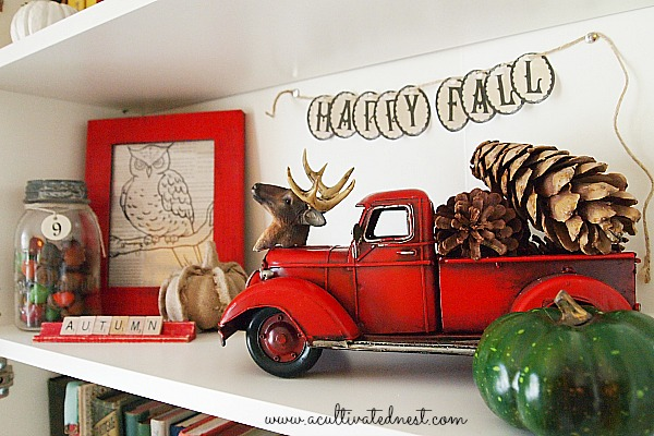 shelf decorated with easy and frugal fall decorating ideas