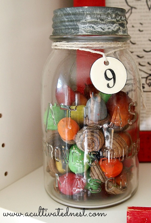 vintage canning jar filled with painted acorns