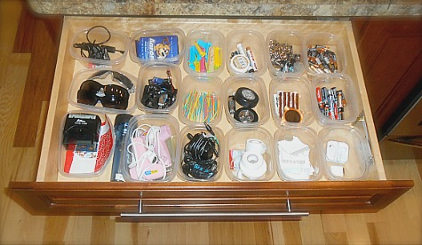 junk drawer organized with plastic containers