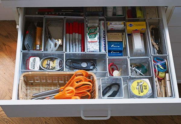organized junk drawer with baskets