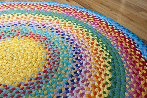 Repurposed t-shirts made into a braided rainbow rug - How To Repurpose Old T-Shirts