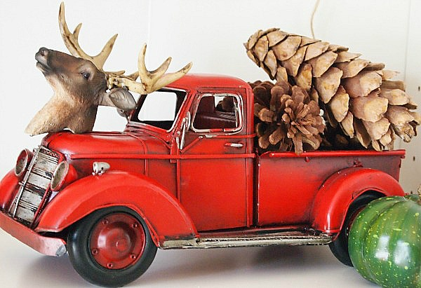 fall decorating idea - red toy truck filled with pinecones