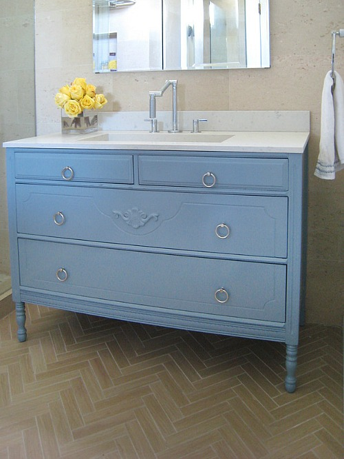 repurposed dresser into a bathroom vanity