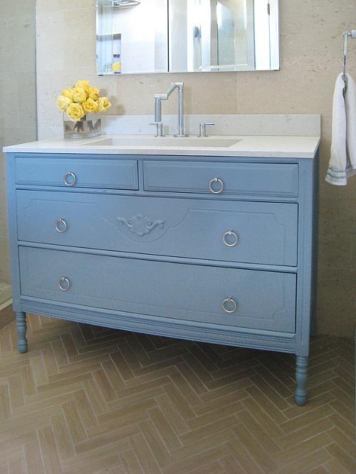 repurposed dresser into a bathroom vanity