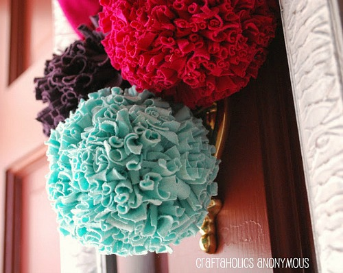Repurposed t-shirts made into pom poms - How To Repurpose Old T-Shirts