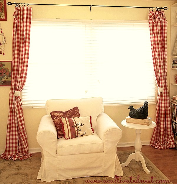 white Ektorp chair and red buffalo check curtains