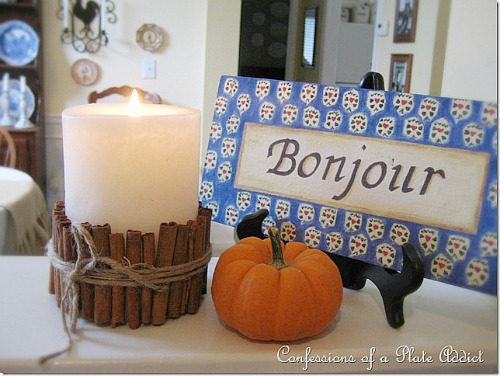 candle-wrapped-with-cinnamon-sticks -Thanksgiving candle display ideas