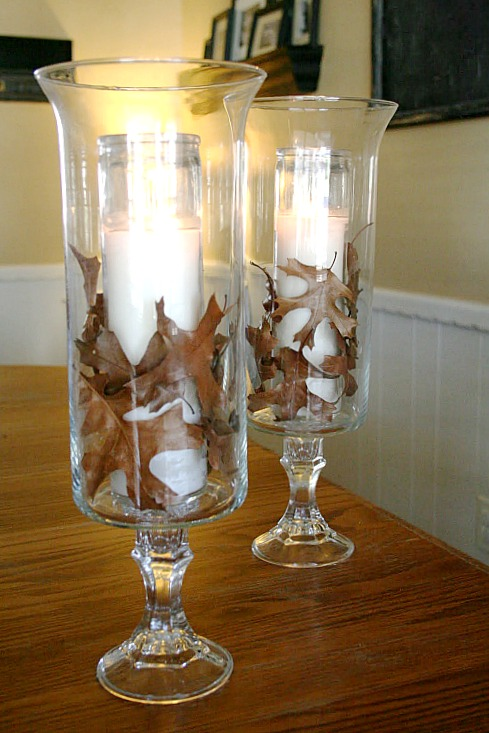 DIY hurricanes with candles and leaves - Thanksgiving Candle Display ideas