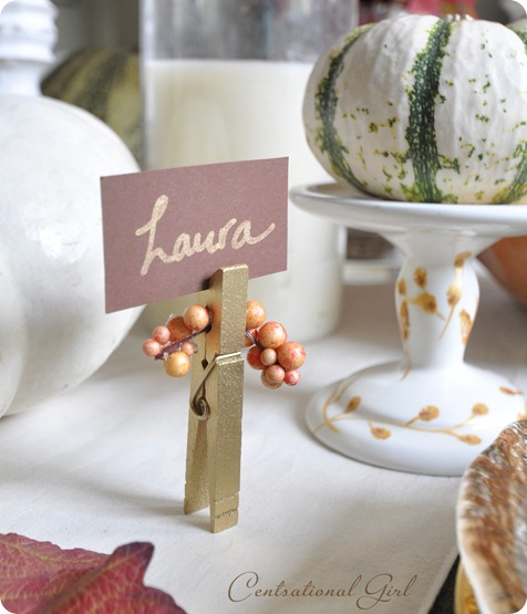 Budget Decorating Ideas for Thanksgiving -Decorating the table for Thanksgiving dinner is so much fun. It's the little details, like place cards, that can add an extra special touch! Really easy DIY Thanksgiving place card ideas.  - gold clothespin place card