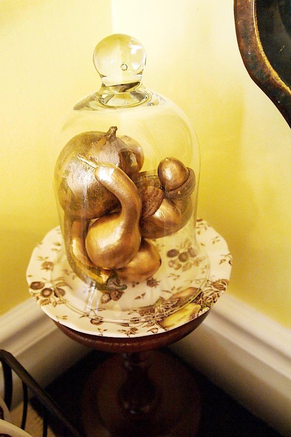 gold gourds under glass