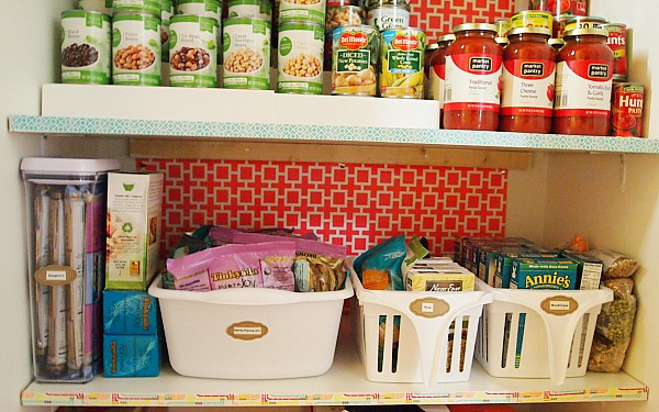 pantry organized with labeled bins