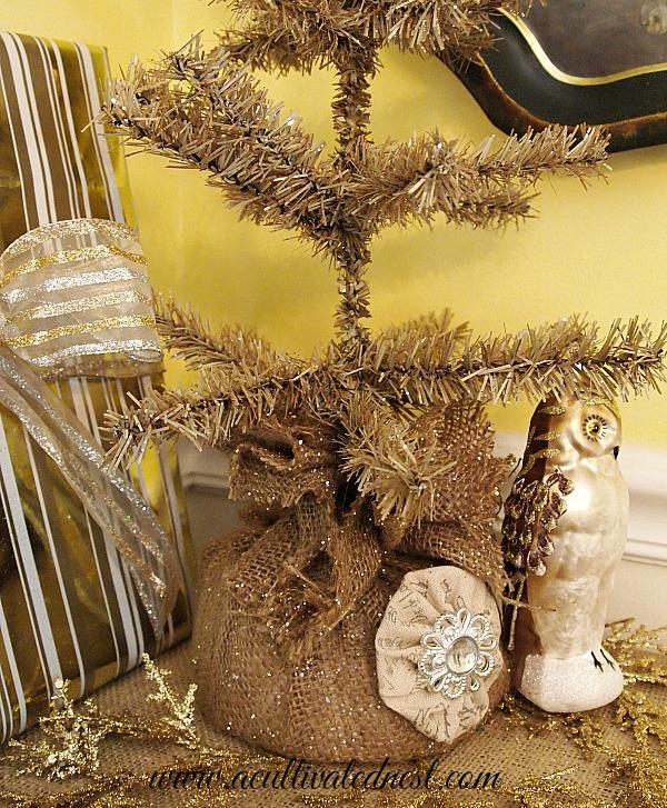 bottle brush tree and glittery bronze owl