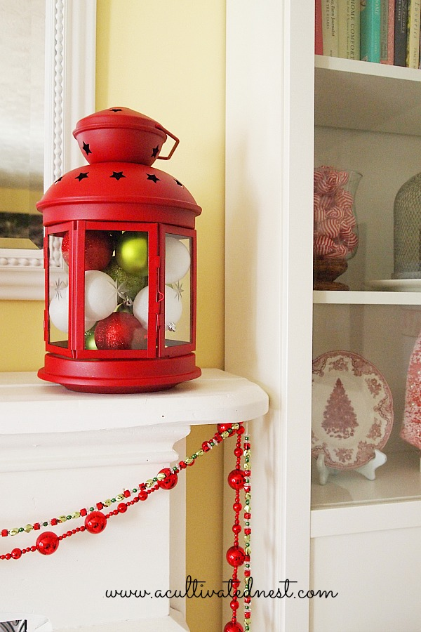 large red Ikea lantern filled with Christmas ornaments