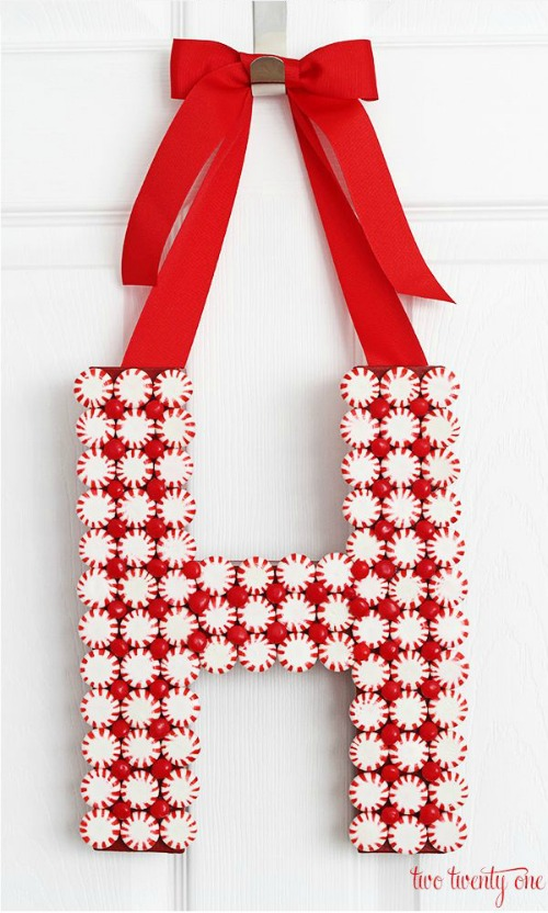 peppermint monogram wreath by Two Twenty One (round up of Christmas Candy Decorations)
