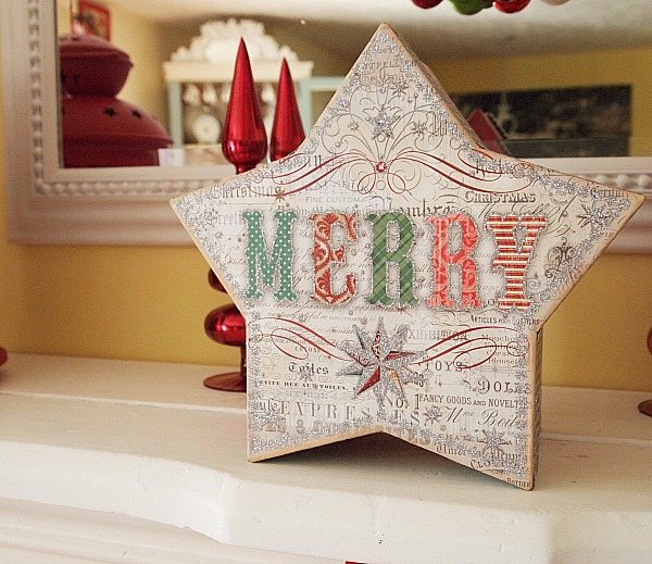 glittery star shaped Christmas box that says merry
