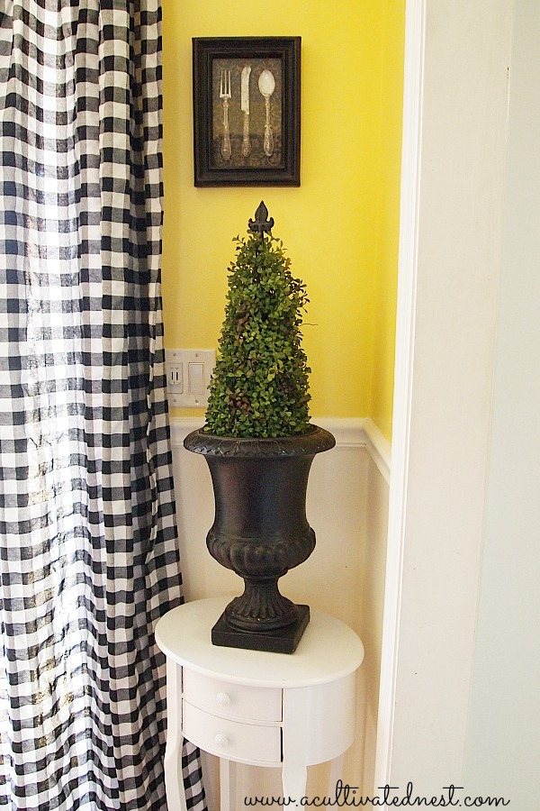 black urn with faux topiary