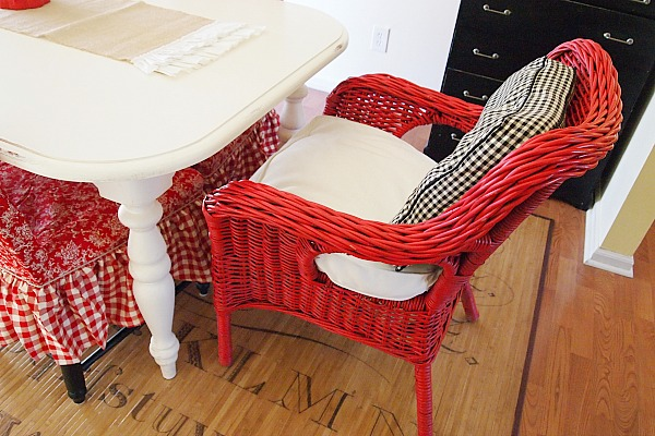 red wicker chair in the dining room